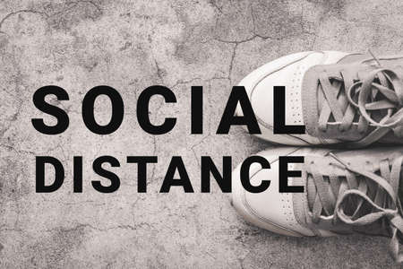 Social Distancing concept. Shoes with text Social Distance.