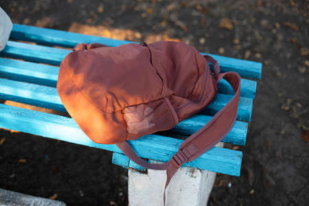 Sports backpack with on a blue bench outdoors