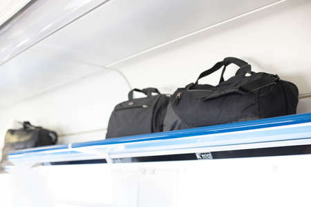 Luggage rack with luggage on the train. Travel concept with copy space