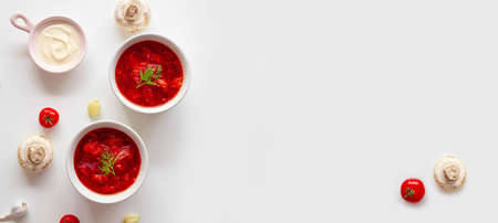 Traditional home Ukrainian beet soup with fresh green dill. Russian borscht in bowl of tomatoes, sour cream, and mushrooms on a white background with minespace. Stok Fotoğraf