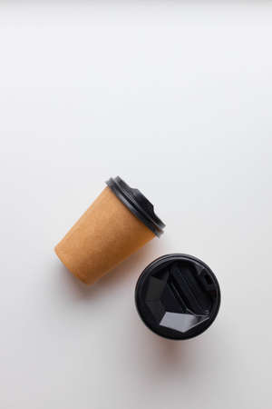 Kraft paper cup with coffee and tea hot drink mockup template on white background. Coffee to go. Flat lay, top view, copy space 版權商用圖片