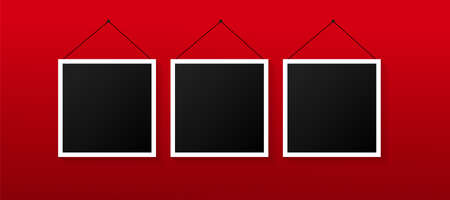 Empty black photo frames set on red background. Images on wall, retro memory album.