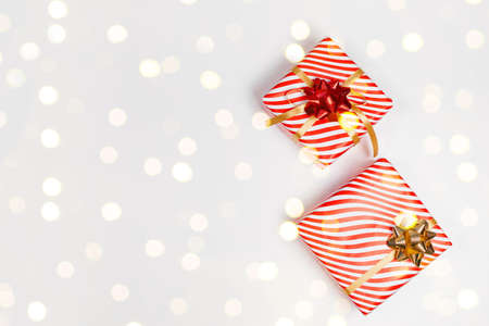 Top view of striped Christmas gift boxes on white background with copy space. Vacation sale, banner, poster composition. Flat lay, xmas banner mockup, greeting card template