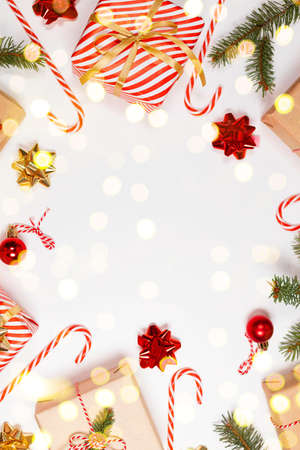 Happy New Year vertical orientation banner. Striped red gift boxes with golden and red bows on a white background.