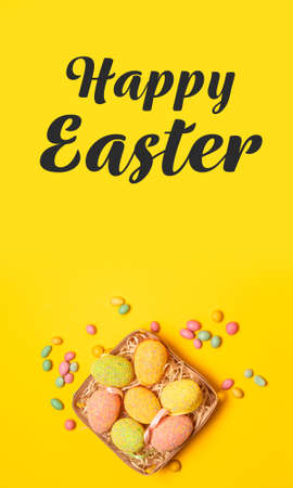 Web banner with color eggs in the nest on soft yellow background. Easter decoration, banner, panorama, background
