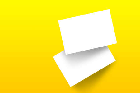 Mockup branding business cards template with shadow on a yellow background. Flat lay, top view.
