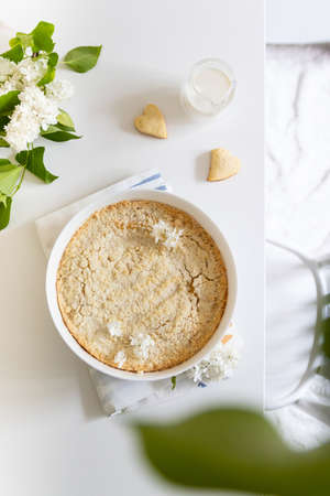Homemade round pie with cream filling, french dessert clafoutis