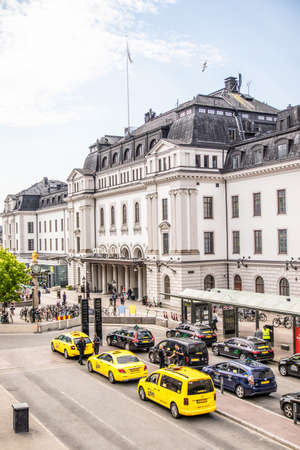 Stockholm, Sweden - June 7, 2019: Central Railway Station, Stockholm, Sweden. Many yellow taxi cars in line on a city street on a sunny day
