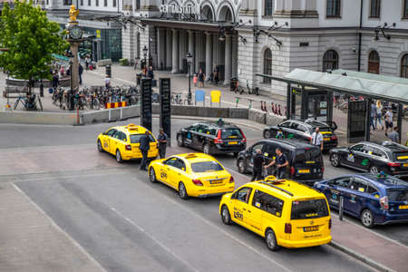 Stockholm, Sweden June 7 2019: Yellow and black taxi cabs waiting in front of Central Railway Station, Stockholm