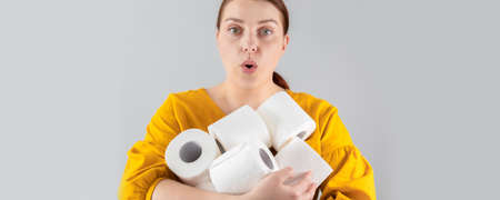 Woman with toilet paper packing. Panic concept, coronavirus danger. You cant leave your house for shopping