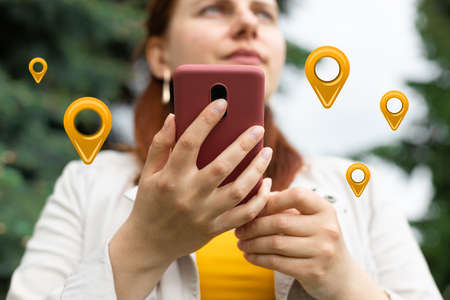 Maps application for smartphone. Woman hand using smartphone with gps navigator map icon outdoors on street. Technology interenet and travel adventure concept. Banque d'images