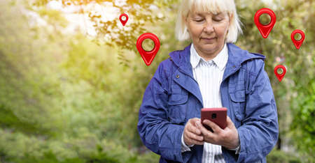 Traveler woman hands use map on mobile phone app to search for route location of place with gps on street when travel in city