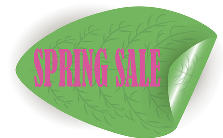 Spring sale. Pink letters on a green leaf. Stock Photo