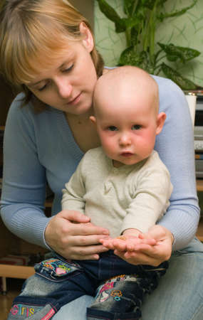 homoeopathic: Image of homoeopathic dragees in a hand of the child