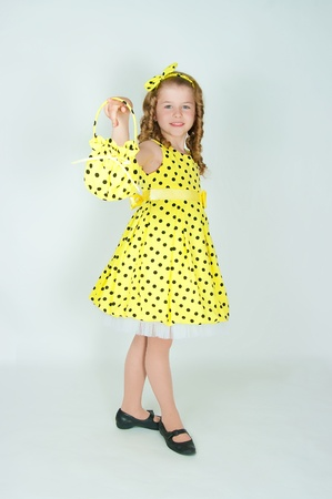 The elegant girl in a yellow dress