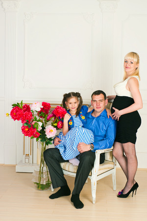 Elegant family with one child in anticipation of the birth of the second child Stock Photo