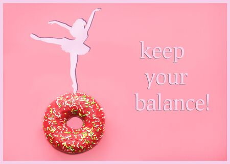 silhouette of a girl standing on a donut. The inscription keep your balance Healthy eating concept.Flat position, top view, copy space -Image Imagens