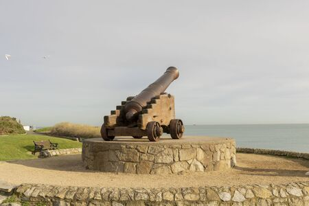 Ancient cannon with sea views located in Dun Laoghaire harbour of County Wicklow in Ireland .