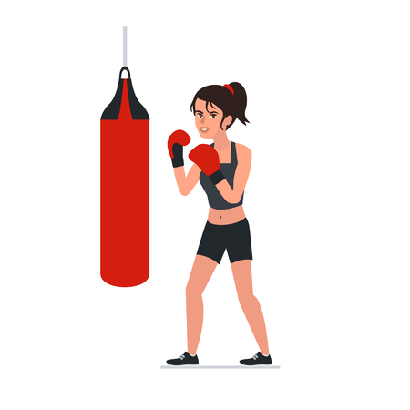 Woman boxing with red punching bag.