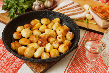 Potatoes baked in the pan as a snack with vodka Stok Fotoğraf