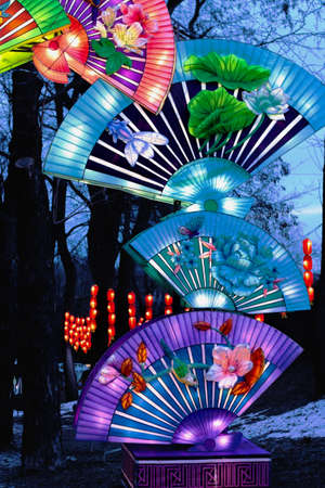 Chinese lanterns are colored fans with images of birds, fish, lotus flowers, butterflies, dragonflies. Symbols of wealth, prosperity, health and well-being. Festival of traditional Chinese lanterns. Imagens