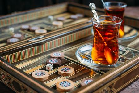 Turkish sweets and tea on the backgammon Board