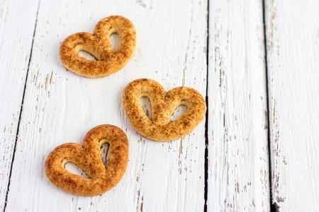 pretzel: Pretzel with cinnamon and sugar on white table Stock Photo