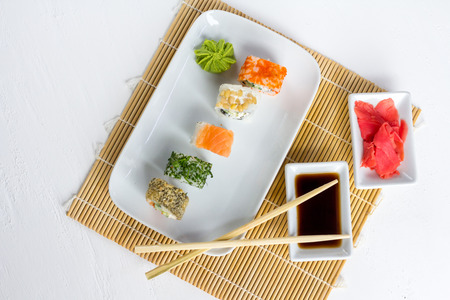 Sushi set on white wooden background with wasabi, ginger and soy sauce Stock Photo