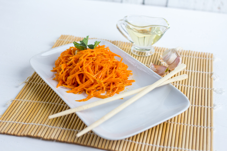 korean salad: Korean carrots on white wooden table