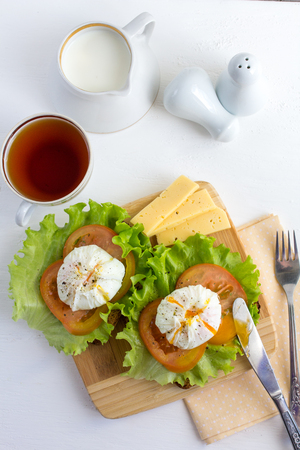 benedict: Healthy Breakfast sandwich with poached eggs. Healthy eating and diet concept. Selective focus.