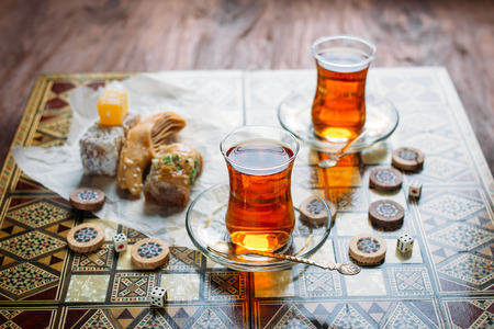backgammon: Turkish sweets and tea on the backgammon Board
