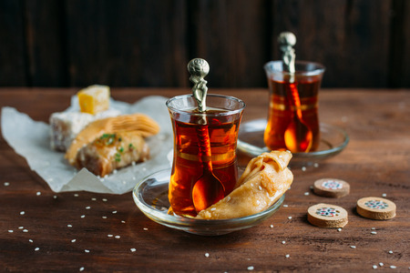 backgammon: Turkish sweets and tea on a dark background
