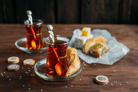 baklava: Turkish sweets and tea on a dark background