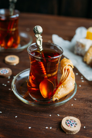 Turkish sweets and tea on a dark background