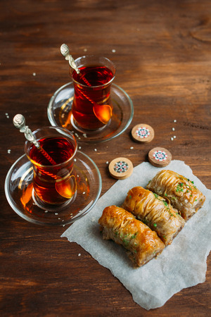 Turkish sweets baklava and tea on a dark background