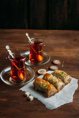 Turkish sweets baklava and tea on a dark background