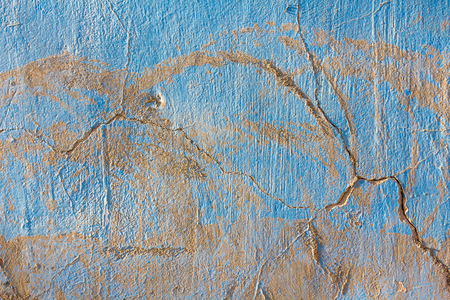 Texture of old plaster with worn blue paint. Vintage, background, wallpaper.