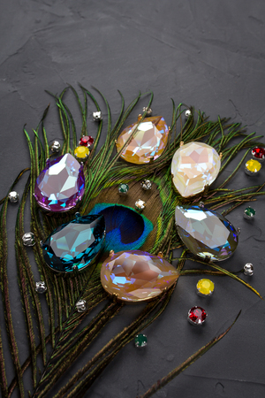 Gemstones crystals for jewelry scattered on a dark background Stock Photo