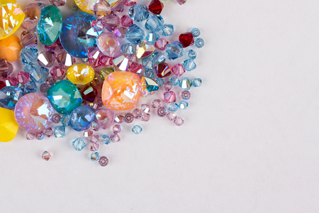 Gemstones crystals for jewelry scattered on white background. The concept of luxury.