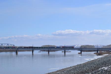 ice floe: Railway bridge across the river. Stock Photo