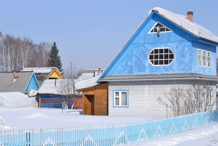 Garden house with a blue attic. Winter.
