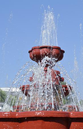 Fountain on blue sky background.