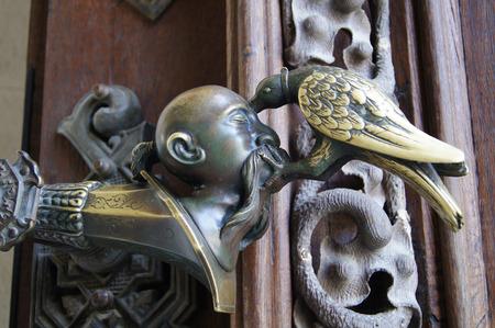 wood molding: crow pecking head doorknob