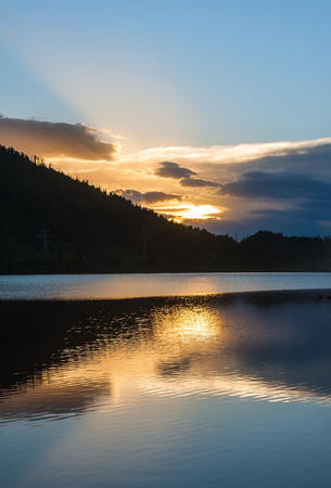 mountains and sky: Beautiful night view of the lake, mountains, sky and clouds at sunset Stock Photo