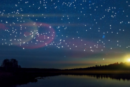 night view: The picturesque night view of the lake, forest, reflections and stars on the background of the colorful sky