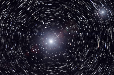 revolving: Abstract decorative background with stars and circle traces of stars revolving around the North Star on the background a black night sky
