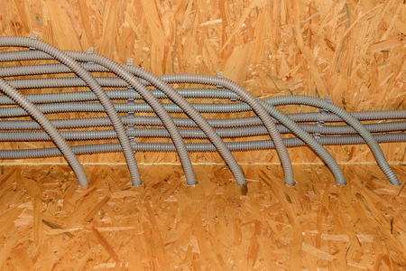 electric material: Gray plastic corrugated pipes with electric cables, reinforced ceiling newly constructed wooden house