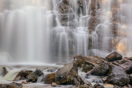 Beautiful waterfall with smooth silky water among rocks and stones, shot on long exposure