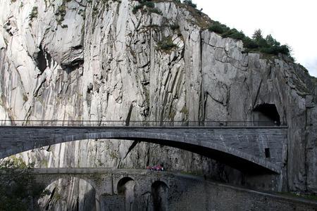 Modern bridge and a tunnel at the Devil's bridge at St.Gotthard, Switzerland Фото со стока