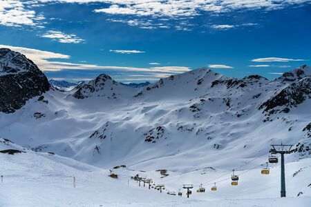 Ski resort in the city of St. Moritz. View of the mountain peaks.